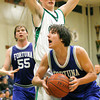 Josh Jackson/The Times-Standard<br /> <br /> Crusaders' Stephen Papstein covers Huskies' Austin Free during Wednesday's game in Eureka.