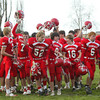 Shaun Walker/The Times-Standard <br /> <br /> Ferndale players gather and celebrate after their playoff victory on Saturday.