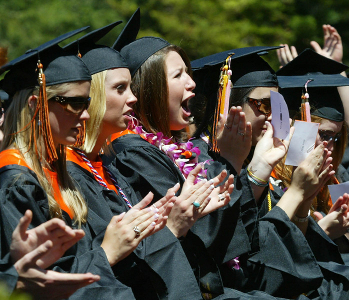 Shaun Walker/The Times-Standard<br /> <br /> Graduating seniors applaud a classmate's speech during Arcata High School's commencement on Thursday afternoon. Over 200 seniors from Arcata and Pacific Coast High graduated in College of the Redwoods Community Stadium.