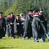 Shaun Walker/The Times-Standard<br /> <br /> Seniors walk past and hug teachers and staff at the start of McKinleyville High's graduation ceremonies on Thursday evening. Nearly 200 seniors from McKinleyville and Community Day School graduated in College of the Redwoods Community Stadium.