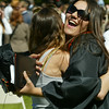Shaun Walker/The Times-Standard<br /> <br /> New AHS graduate Charlena Luna, 18, shares a big hug with her friend Leah Lalonde after ceremonies on Thursday afternoon. Over 200 seniors from Arcata High and Pacific Coast High graduated in College of the Redwoods Community Stadium.