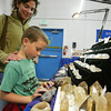 Shaun Walker/The Times-Standard<br /> <br /> Katy Longshore of Woodland and her son Charlie, 7, wander at the Lost Coast Jewelry, Gem, Bead, and Mineral Show at Redwood Acres Fairgrounds in Eureka on Friday afternoon. The event, which continues today [SATURDAY] from 10 a.m. to 7 p.m. and Sunday from 10 a.m. to 5 p.m., features 27 vendors and a portion of the entrance fee helps support local 4-H clubs.