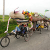 """José Quezada/For the Times-Standard<br /> <br /> Compost Sheep and the Garden Girls bring an organic message to their kinetic art machine as it glides along Cannibal island Road in Loleta. The second day of the 40th """"Ruby"""" anniversary Kinetic Grand Championship started with a splash into Humboldt Bay from the Eureka Marina on Sunday. Colorful human-powered kinetic machines left the sand and pavement for a short wet swim in the bay to the Samoa Bridge boat landing, then back south along Highway 101, up Tompkins Hill, then down through the Loleta farm bottoms to Crab Park. The three-day race concludes tomorrow morning as the artistic machines cross Fernbridge before finishing up on Main Street in Ferndale."""
