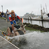 """José Quezada/For the Times-Standard<br /> <br /> The """"Big Friendly Giraffe"""" enters the bay with panache to the roar of a huge crowd lining the Eureka marina Sunday morning. The second day of the 40th """"Ruby"""" anniversary Kinetic Grand Championship started with a splash into Humboldt Bay from the Eureka Marina. Colorful human-powered kinetic machines left the sand and pavement for a short wet swim in the bay to the Samoa Bridge boat landing, then back south along Highway 101, up Tompkins Hill, then down through the Loleta farm bottoms to Crab Park. The three-day race concludes tomorrow morning as the artistic machines cross Fernbridge before finishing up on Main Street in Ferndale."""