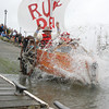 """José Quezada/For the Times-Standard<br /> <br /> The """"Ruby Dew"""" enters the bay with an impressive splash to the delight of the crowd lining the marina. The second day of the 40th """"Ruby"""" anniversary Kinetic Grand Championship started with a splash into Humboldt Bay from the Eureka Marina on Sunday. Colorful human-powered kinetic machines left the sand and pavement for a short wet swim in the bay to the Samoa Bridge boat landing, then back south along Highway 101, up Tompkins Hill, then down through the Loleta farm bottoms to Crab Park. The three-day race concludes tomorrow morning as the artistic machines cross Fernbridge before finishing up on Main Street in Ferndale."""