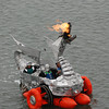"""José Quezada/For the Times-Standard<br /> <br /> Duane Flatmo's """"Tin Pan Dragon"""" belches out a glorious and fiery salute to the folks watching along Humboldt Bay. The second day of the 40th """"Ruby"""" anniversary Kinetic Grand Championship started with a splash into the bay from the Eureka Marina on Sunday. Colorful human-powered kinetic machines left the sand and pavement for a short wet swim in the bay to the Samoa Bridge boat landing, then back south along Highway 101, up Tompkins Hill, then down through the Loleta farm bottoms to Crab Park. The three-day race concludes tomorrow morning as the artistic machines cross Fernbridge before finishing up on Main Street in Ferndale."""
