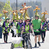 Shaun Walker/The Times-Standard<br /> <br /> Gladys the Green Giraffe team members circle the plaza at the Kinetic Grand Championship in Arcata on Saturday.