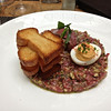 Prime beef tartare with fennel and parmesan on brioche toast