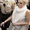 Lindsay Lohan arrives at the Los Angeles Superior Court West District Airport Courthouse Wednesday, Oct. 19, 2011, in Los Angeles. A city prosecutor will recommend Wednesday that the troubled starlet be sent back to jail because she had been ousted from a community service assignment at a women's shelter. (AP Photo/Damian Dovarganes)
