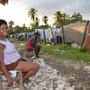 Women who went from living in the IDP camp on the right to getting a proper house to the left, Leogane, Haiti (Photo: NORCAP/Åshild Falch)