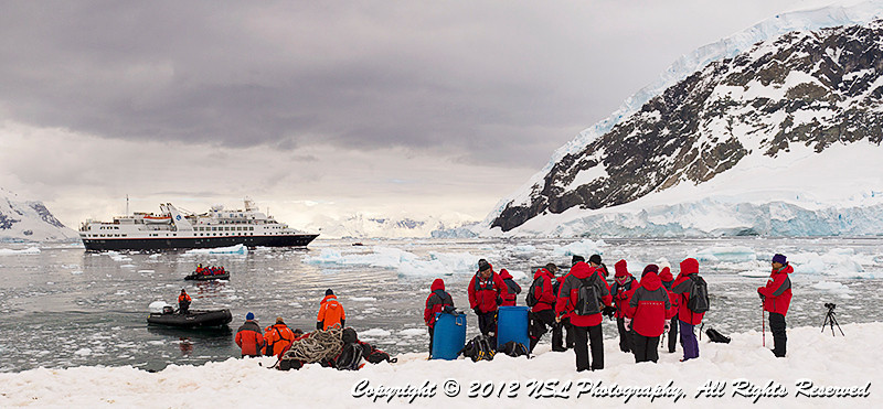 Ashore at Neko Harbor, an inlet on the Antarctic Peninsula on Andvord Bay, situated on the west coast of Graham Land, with the Silver Explorer (Silversea Cruises, Ltd.) anchored in the harbor.