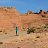 Lisa on the edge of the Delicate Arch Upper Viewpoint