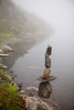 Fog and Lake - A carefully balanced stone statue stands on the edge of Hoh Lake in the fog.