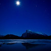 Rundle Mountain, Banff National Park, under a full winter moon, with the Vermillion Lake in the foreground.
