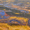 A small sample of the Okavango Delta from the air.  At this season (April 2012), the water is rising, flowing into the waiting channels, forming new islands, and creating a tapestry of old desert colors beside patches of fresh green (2)