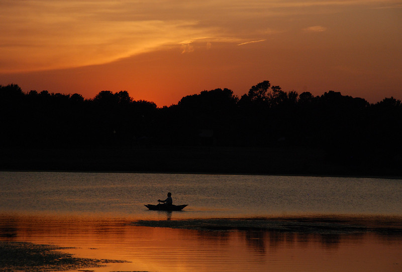 Boating at Sunset: Exercise and natural beauty combine for this man at the close of day. Location - Old City Lake, Ennis, Texas.