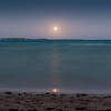 Moon rising over turquoise Caribbean water