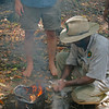 The ranger starts the fire with bark from the Paper bark tree.  it starts right up and then place some special branches of leaves in the fire.