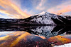 Red sunset reflection of Mount Vaught on Lake McDonald in Glacier National Park