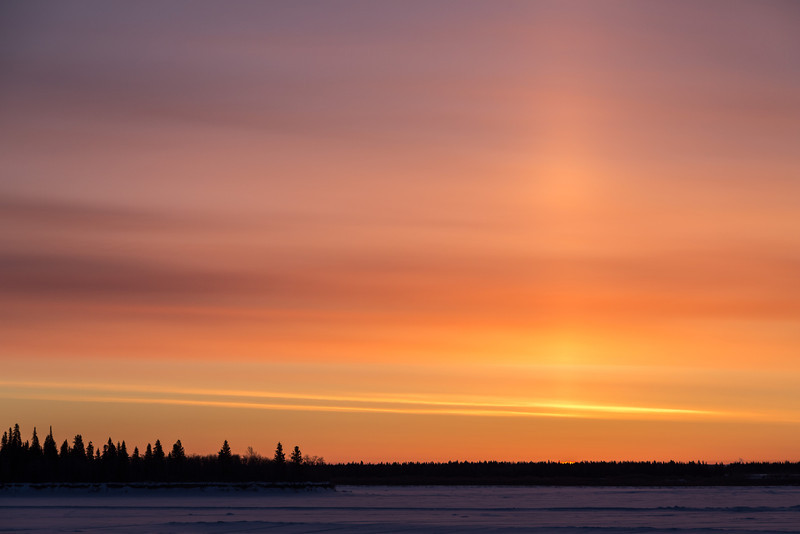 Sunrise across the Moose River at Moosonee, Ontario. First hint of the rising sun.