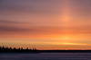 Sunrise across the Moose River at Moosonee, Ontario. Rising sun growing bigger.