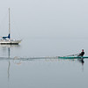 © Paul Conrad/Pablo Conrad Photography - A rower glides across Bellingham Bay in Bellingham, Wash.