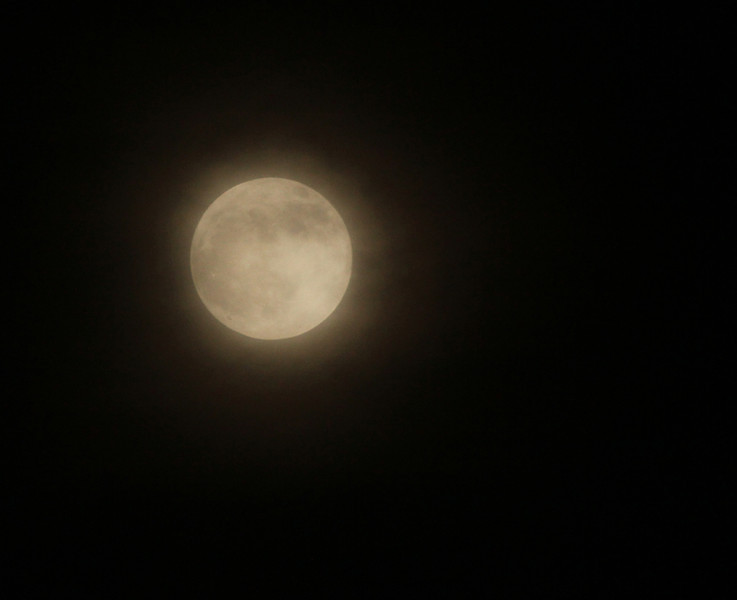 Full Pink Moon at 100% of full  Pre-Lunar Eclipse on a very cloudy and humid night April 14, 2015