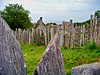 Reproduction of 17th century fences and huts in Plymouth Village, Massachusetts.