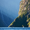 Tour boat dwarfed on Milford Sound, Fiordland Ntional Park