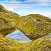 Alpine pond on Conical Hill, Mt. Aspiring National Park, West Coast, New Zealand