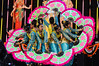 Young indian girl dancers in elaborate costume performing on stage withn brightly coloured fans<br /> Diwali celebration<br /> Aotea Square<br /> Auckland