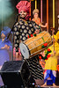 Indian man dancer  with a drum, wearing an elaborate turban<br /> Diwali celebration<br /> Aotea Square<br /> Auckland