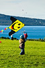 Little girl flying smiley kite<br /> Bastion Point<br /> Auckland