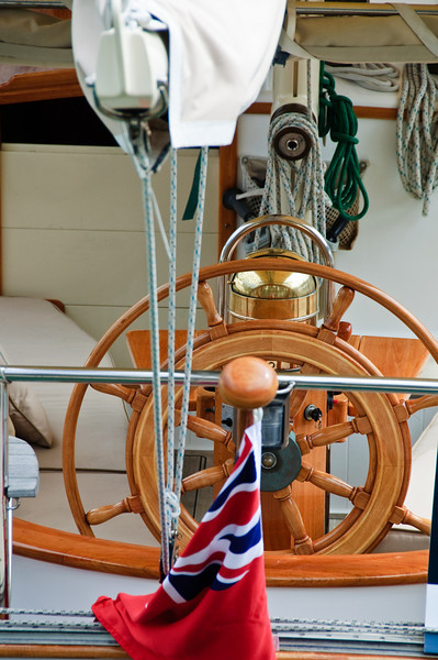 View of the helm of a sailing boat moored at the Viaduct Basin in Auckland