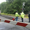 BRYAN EATON/Staff Photo. An MBTA commuter train sits idle on the tracks just north of the Hay Street crossing gate after a female body was found on the railway.