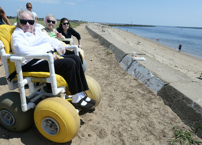 BRYAN EATON/ Staff Photo. Residents of Merrimack Valley Health Center in Amesbury had a cookout and outing at Salisbury Beach State Reservation on Thursday. Taking in the view of the Merrimack River, from left, Violet Frothingham,  Joyce Grace and Beverly Kalil.