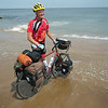 JIM VAIKNORAS/Staff photo Keith Harris dips his bike into the Atlantic Ocean on Plum Island after completing his 4,400 mile bike ride from Seattle to Newburyport. Harris's ride raised over $35000 for the Rotery Club.
