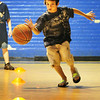 BRYAN EATON/ Staff Photo. Lucas Bistany, 8, of Salisbury moves down the court in a basketball and hockey relay at the Boys and Girls Club gym on Wednesday. The club will be closed during the first week of school next week and then open up for afterschool programs on September 8.