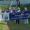 JIM VAIKNORAS/Staff photo  Cancer survivor lead the Relay For Life at Landry Stadium in Amesbury Saturday afternoon.