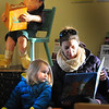 """BRYAN EATON/ Staff Photo. Sativa Saposnek with her daughter Saskia have the small reading area in the Children's Room at the Newburyport Library to themselves Monday afternoon. The Newburyport resident was reading the two year-old """"Little Quacks Bedtime."""""""