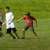 BRYAN EATON/Staff Photo. Youngsters play a game of soccer on Monday at Amesbury Town Park in the town's summer program. The rest of the week looks good for activities there except for Thursday which may bring a shower.