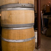 Wine and whiskey barrels sit in Chris' basement/workshop to be cut up.