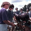 Hallsville head football coach Steve Gaddis explains the next play to his offensive players.  Lester Phipps, Jr.