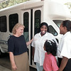 Area Transportation of ET moves into new building on S. Green. Alice Plummer, Vivian Crayton, Madalyn and Valerie Warren in front of new bus. Chris Matula photo.