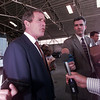Governor George W. Bush meets with reporters following the ceremony at Gregg Airport 8-21.