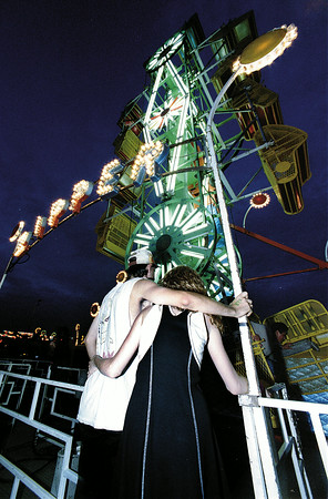 """Sonny Morgan and Cindy Paxton wait their turn to ride """"The Zipper"""" and the ET Regional Fair. Nice evenings have resulted in good turn-outs for the carnival and exhibits. Chris Matula photo."""