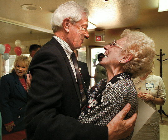 Congressman Ralph Hall laughs with Nauty Mayer at his town meeting visit to Care Inn home in Gladewater Thursday afternoon. Hall came to speak to residents and health care professionals on Medicare changes. Chris Matula photo.