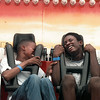 Aaron Robertson, 15, can't stand it anymore as he grabs onto the arm of his friend Brandon Brown, 15, on The Double Shock ride at the ET Regional Fair Saturday. Chris Matula photo.