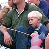 2-1/2-year-old Casey Morris of Harleton and dad Steve watch the performers at the annual Shrine Circus presented at the Longview Fairgrounds rodeo arena Friday afternoon.  Proceeds of the event go to aid the Shriners Crippled Children's Hospitals.  Lester Phipps, Jr.