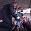 Governor George W. Bush gives 6-year-old Jessica Olson of Longview a lift up to the stage so her mom can get a photo of them together.  Lester Phipps, Jr.